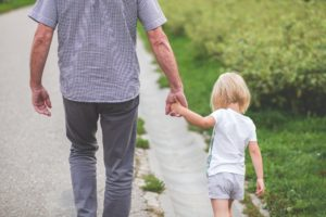 Man walking with daughter
