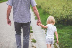 Man walking with daughter