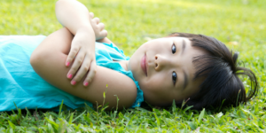 Little girl on grass, pesticides crisis averted